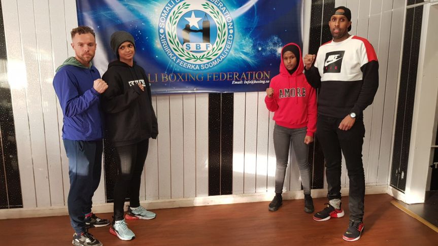Coach Richard Moore and his three Somali Boxers